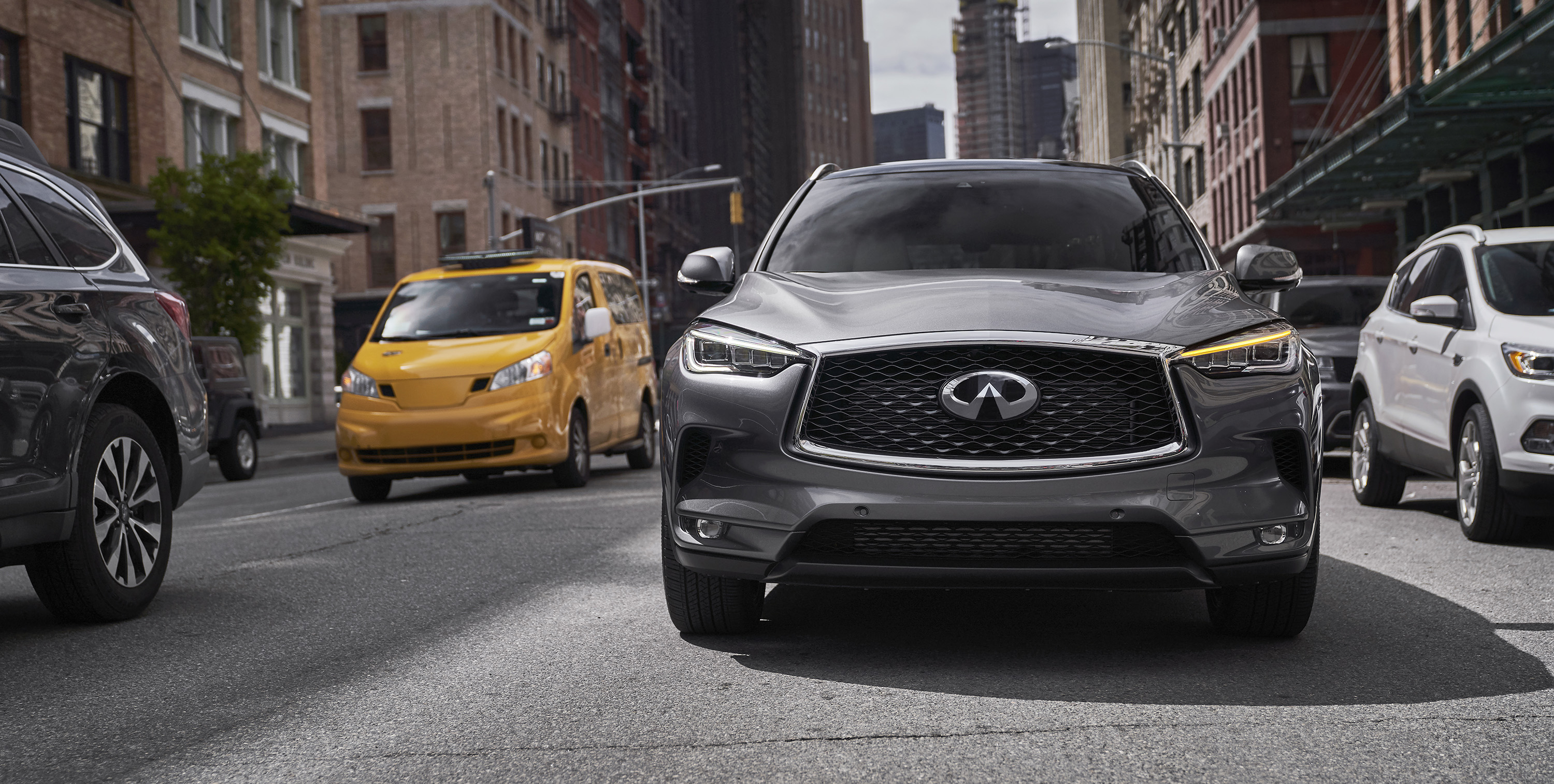 2020 INFINITI QX50 Luxury Crossover Driving Through An Urban Area